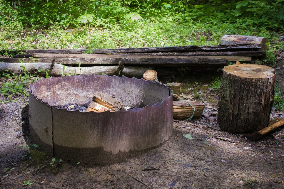 secluded fire pit at the edge of the property