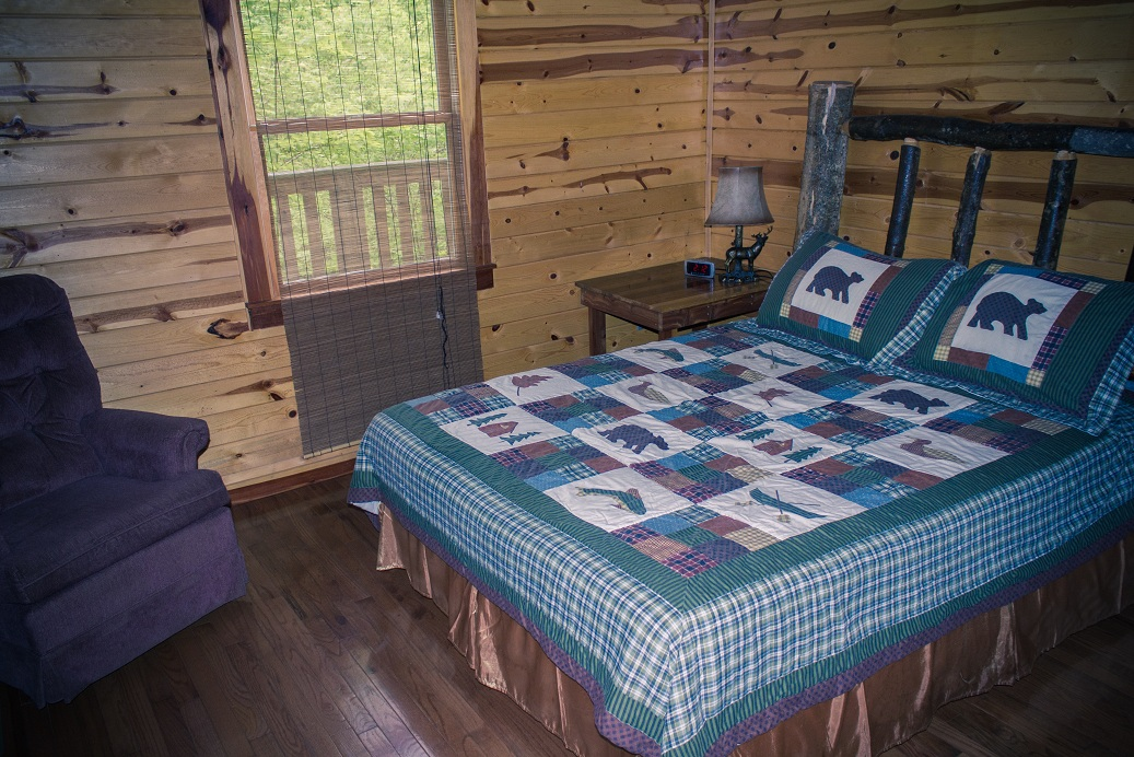 comfortable bed with rustic quilt