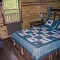rustic quilt and cozy bed