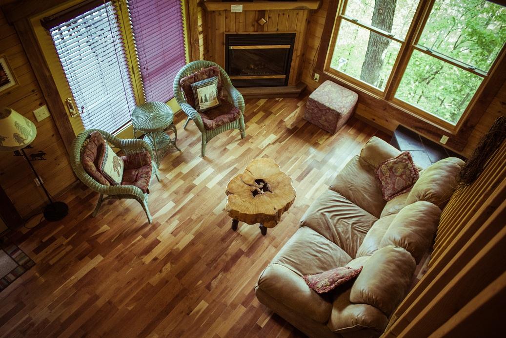 rustic living room with cherry hardwood flooring
