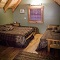 airy cabin loft with two queen beds