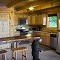 stainless steel appliances and black bear bar with stools