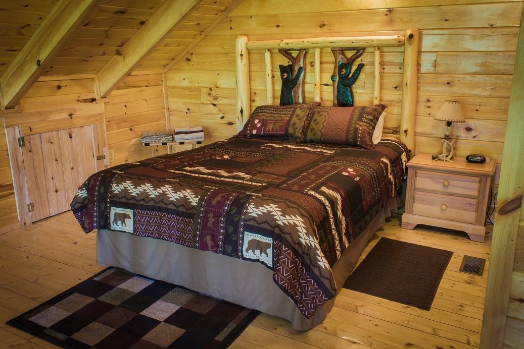 handmade black bear log bed