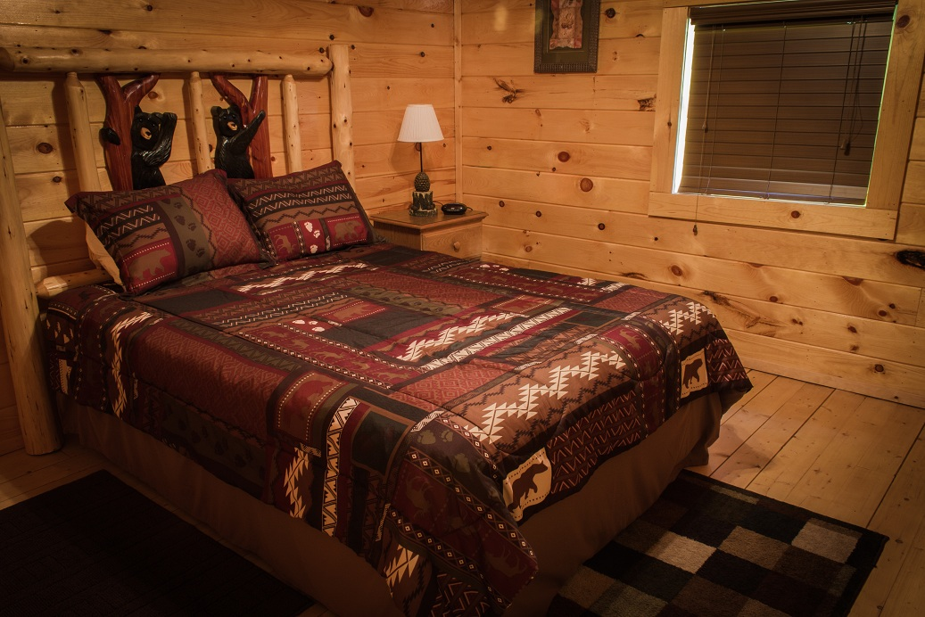 handcrafted log bed with black bears