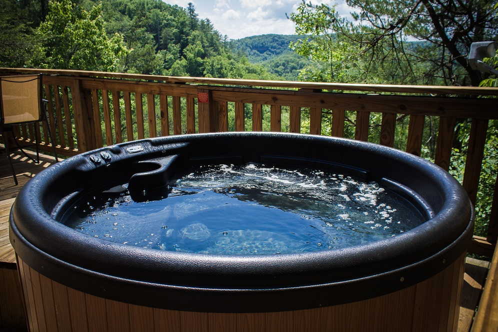 enjoy the view while taking a dip in the hot tub