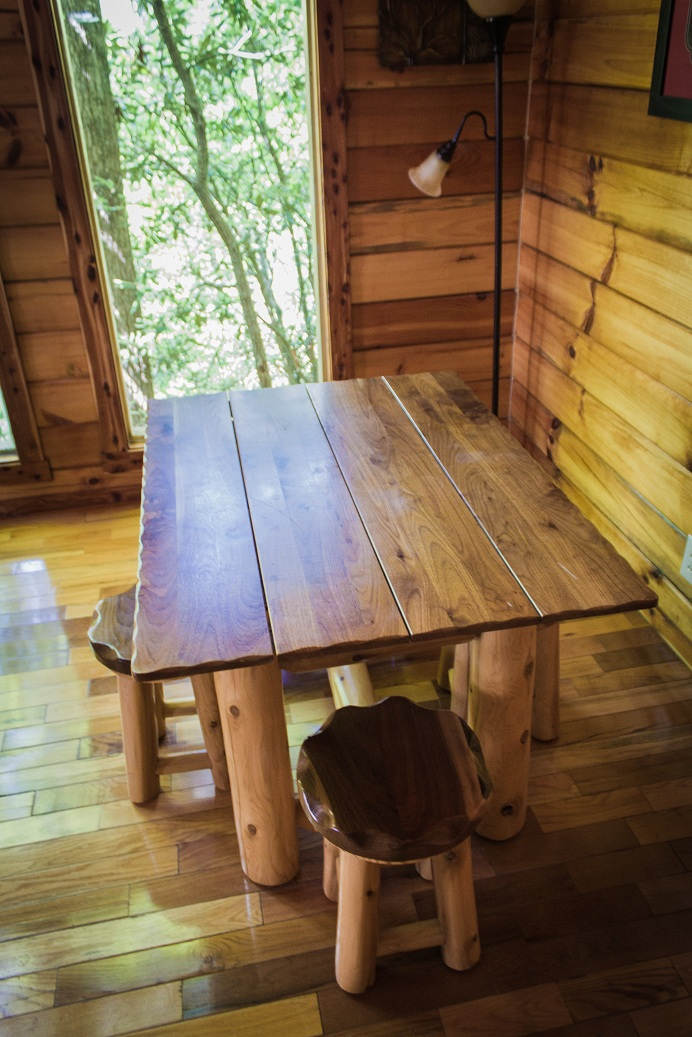 charming dining table and stools for four