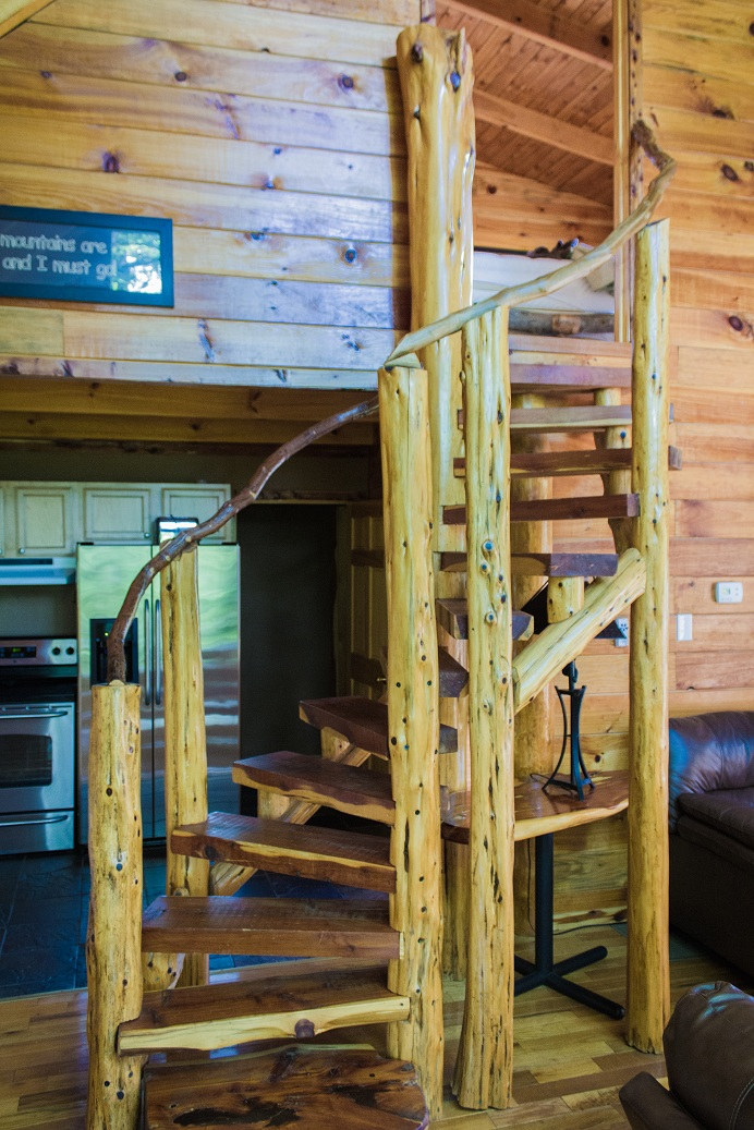handcrafted log spiral staircase