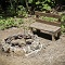 rustic bench and rock fire pit