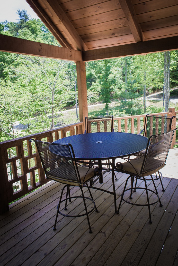 appreciate the view rain or shine on the covered deck