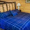 king size bed with royal blue comforter