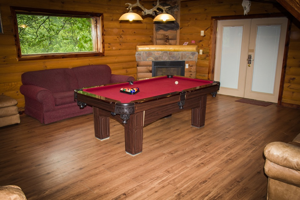 enjoy a game of pool by the fire