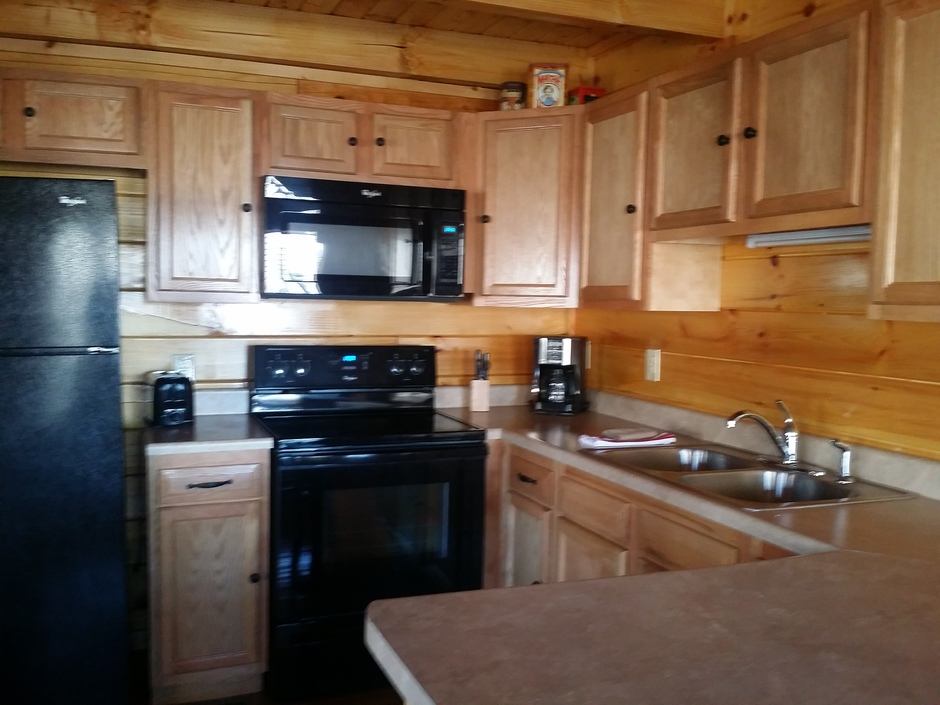 fully equipped kitchen with cookware