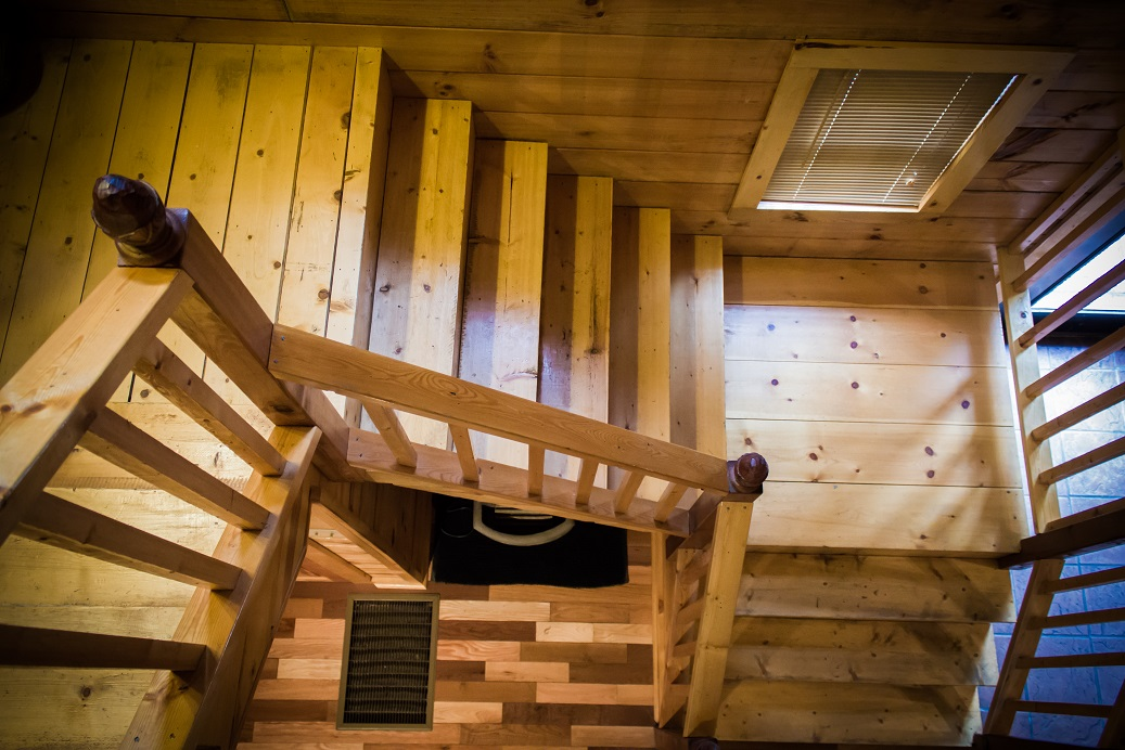 beautiful wood flooring and stairs in rental cabin