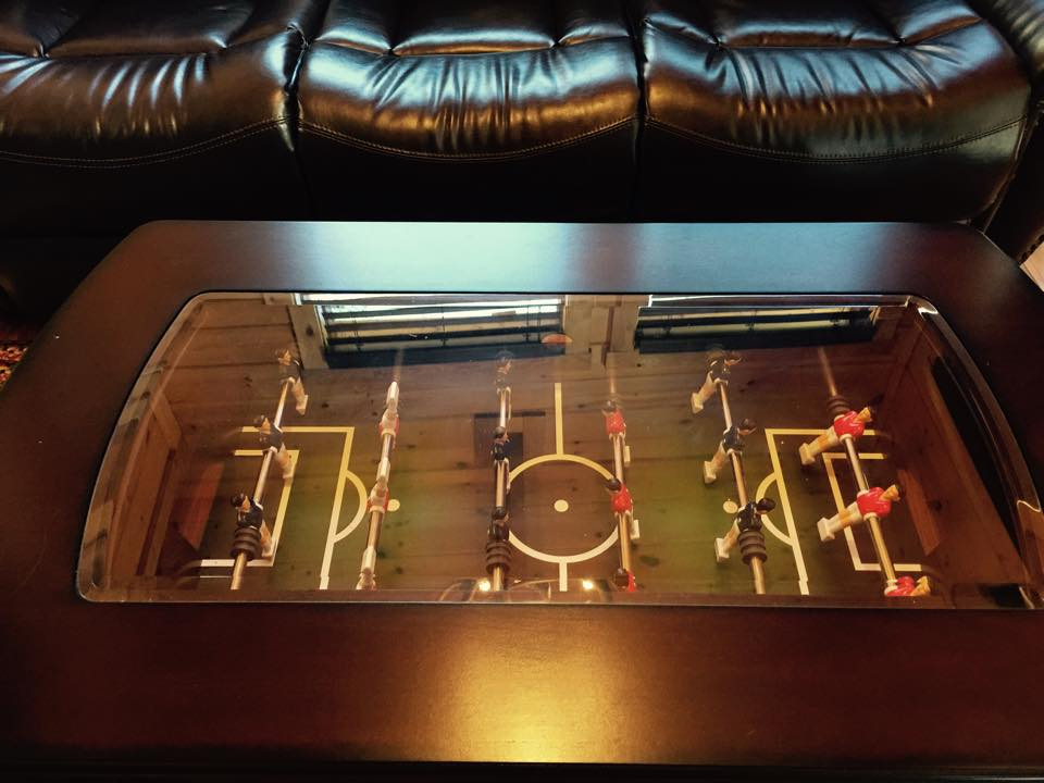 play a game of Foosball while inside