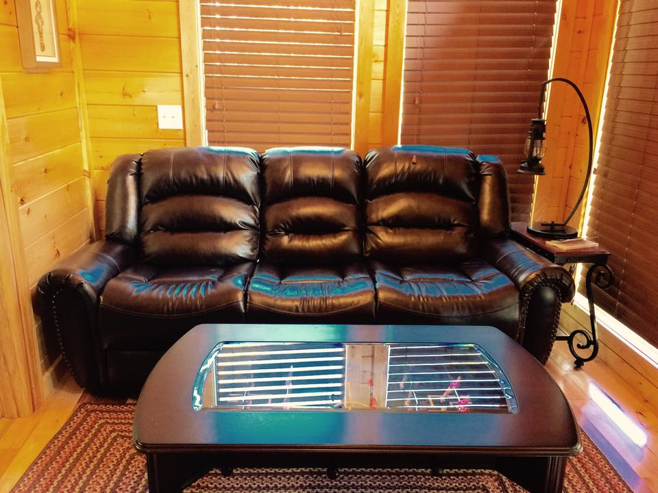 full leather couch in cabin living room